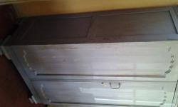 Vintage two door wooden cupboard with two draws and