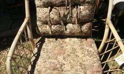 Wicker single seater chair that has been left in the
