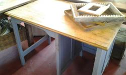 Old wooden desk that does not have any draws but a