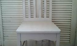 Wooden Dining Chairs that we have painted in cream,