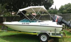 Sensation boat with 125 mercury motor spotless