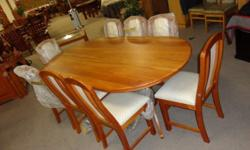 Cherry wood table with eight upholstered chairs - in