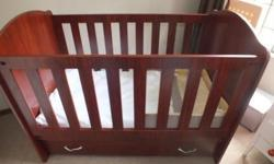 Clarissa mahogany cot with sliding safety rail, drawers