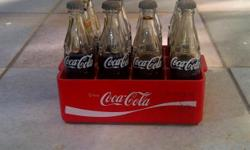 Beskrywing Hi i have this very old miniature coca cola