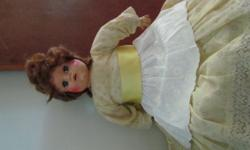Beskrywing An original porcelain doll with original