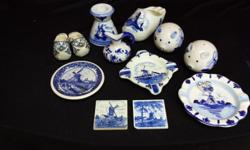 Collection of blue and white ceramic pieces. Some Blue
