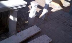 16 small concrete pillars and 2 large ( 2m ) concrete