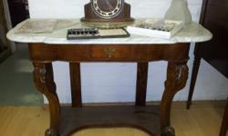 Antique marble top side table with drawer. Intricate