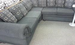 Black corner couch for sale plus free glass coffee