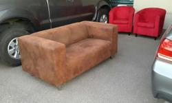 I am selling a brown 2 seater couch and 2 x red bucket