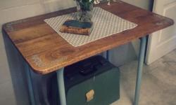 A beautiful little Country Cottage Table with a wooden