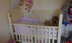 Large cot including mattress for sale. It is cream in