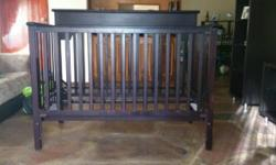 Dark wooden cot for sale. Still in a good condition.