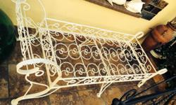 Antique wrought iron daybed with mattress on top