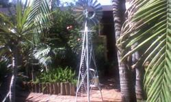 Beskrywing DECORATIVE GARDEN WINDMILLS THAT PUMPS WATER