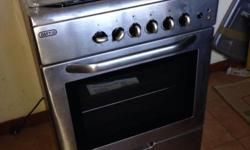 4 Plate Gas Stove with electric oven. Tempered glass
