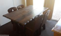 Solid dark wood Dining room table with 4 chairs.
