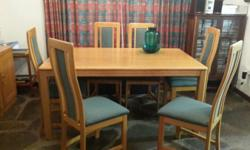 Dining table (oak) with six chairs and a server. Was a