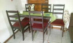 Diningroom table and five chairs. Value R800 Shower