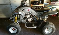Selling a Dinli 450cc quad 4 wheeler. Grey in colour, 5