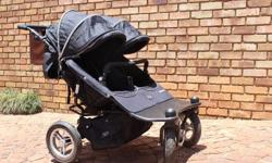 Double pram imported from Australia. Mint Condition.