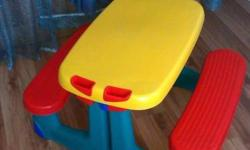Hard durable plastic table with a bench on either