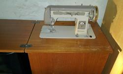 EMPISAL SEWING MACHING STILL IN GOOD WORKING