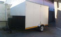 Enclosed trailer with two big side doors, rear door and