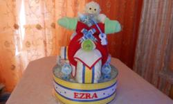 Adorable baby Shower Gifts. These Diaper cakes are made