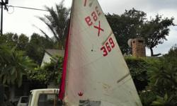 Wooden sailing dinghy in good sailing condition. All