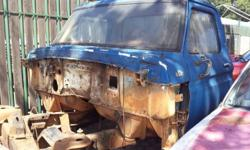 Ford F100 cab with glass and seat. Good condition no