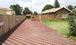 Facebrick house with nice paving in drive-way. Open