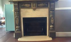 Fireplace complete with mantel and marble surrounds for