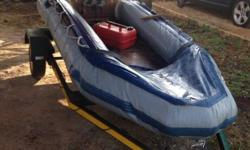 Exelent fishing boat with trailor . 25 horse motor