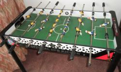 Beskrywing A moderately sized,multi-colouredfoosball