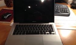 A MacBook Pro 13 inch laptop in perfect condition for