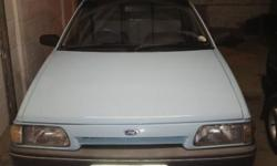 Hi I'm selling my ford laser. Papers In order new