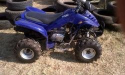 Four wheeler, Wonjan 200cc, manual, in mint condition,