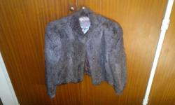 100% rabbit fur coat, still is super condition. Size is