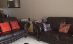 Two brown leather couches, black tv stand, samsung HD