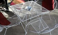 I have a Metal Garden Table and Four chairs for sale in