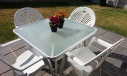 I am selling a nice Garden table and four chairs ,