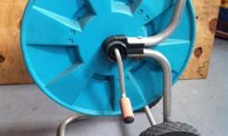 Selling my Gardena hose reel as is. With out hose or