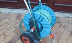 Good condition reel trolley and hose as shown. Please