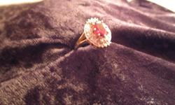 9ct yellow gold ring wth garnet and diamonds. the