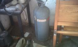 Gas cylinder for domestic use, 3/4 full.
