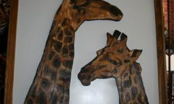 Beskrywing Wooden segmentation & stained giraffes on a