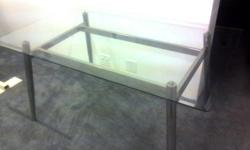 6 Seat Dining Table. Glass top with chrome stand.