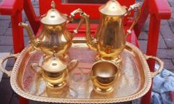 Gold plated tea and coffee set. Includes: tea pot,