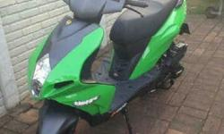 Brand New Green Scooter comes with free helmet Petrol